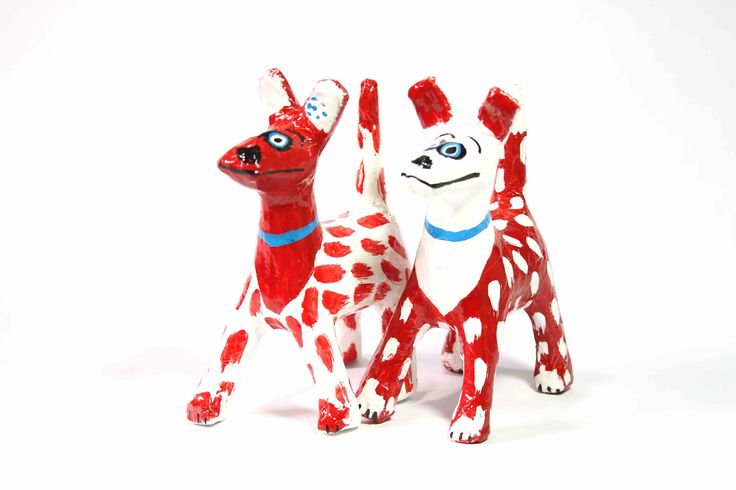 Papier-Mache Spotty Dog (Red/White): This handcrafted papier-mache dog was made using recycled newspaper.  Each one is hand painted making them all unique and individual.  It is sure to add colour and happiness to the room.