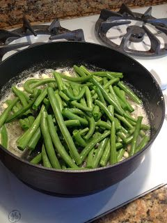 GREEN BEANS ==Ingredients== 1 lb. fresh green beans, 3-4 cloves of garlic, 2-3 T. olive oil, 2-3 c of chicken broth, 3-4 T. butter, Salt and pepper to taste ====