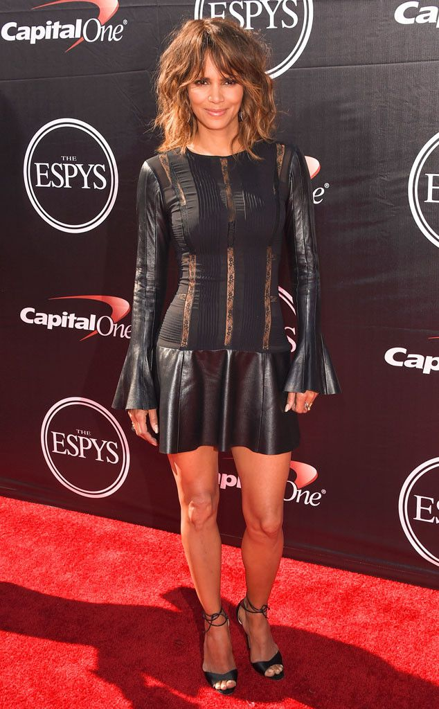 Halle Berry from 2015 ESPY Awards Red Carpet Arrivals  As always, the actress is gorgeous in a black fit-and-flare with thin sheer illusion panels.