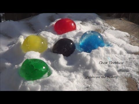 I saw a description on facebook from pintrest about freezing water balloons with food coloring in it to make beautiful colored frozen orbs. I had to try it! ...