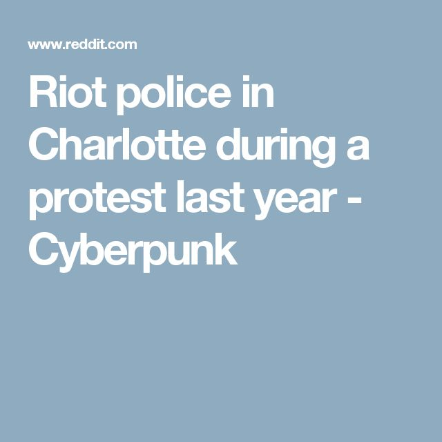 Riot police in Charlotte during a protest last year - Cyberpunk