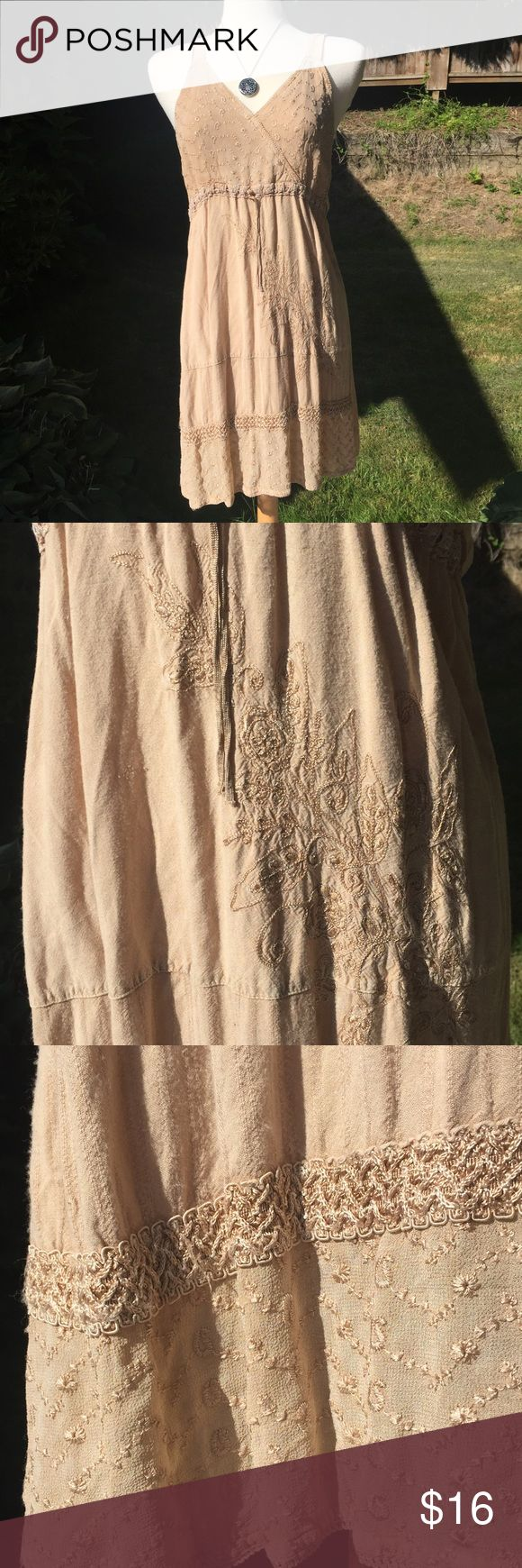 Adorable embroidered summer dress Beige embroidered summer dress, lightweight and cool. Featuring a drawstring waist, and really beautiful embroidered detailing. Size Small. Dresses Midi