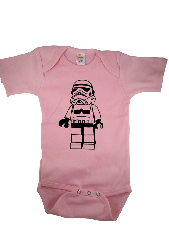 Startin' 'em a little young in the Empire, aren't they?   Storm Trooper Star Wars Baby Girl Onesie Bodysuit