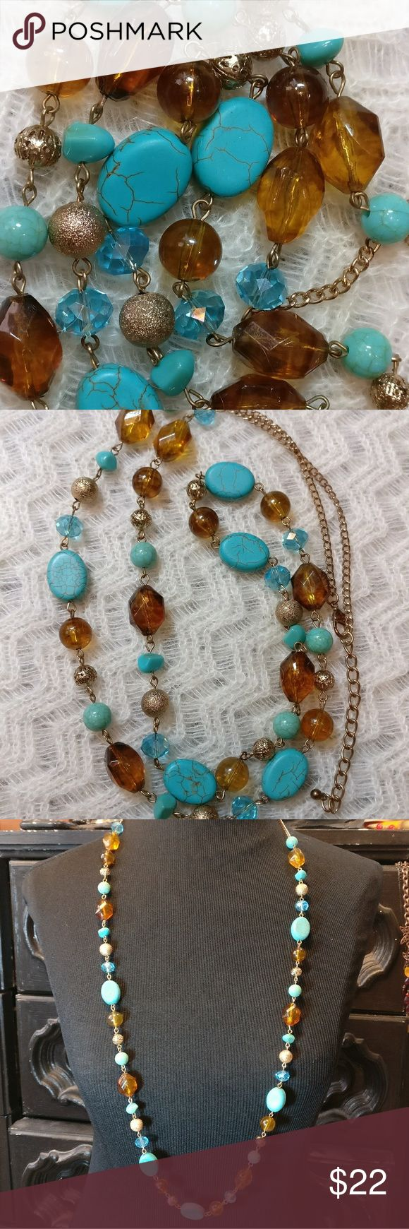 Turquoise Amber Blue Faceted Crystal Long Necklace In good condition. Minimal wear. Amber Lucite. Turquoise colored glass. Faceted Blue Crystals. Gold Filigree Spheres. Adjustable length. Gold tone. Jewelry Necklaces