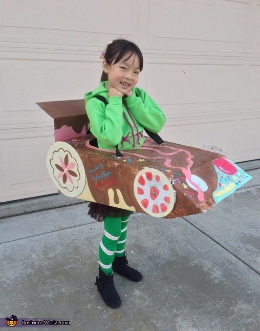 Jenn: My daughter is wearing a costume we put together for her as Vanellope from Wreck-it-Ralph. My other daughter and husband made the go-kart for her and I put her costume...