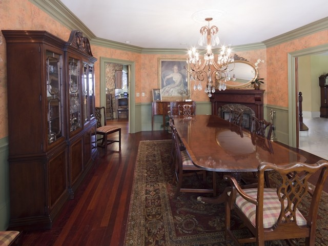 Formal dining room working fireplace chandelier for Traditional dining room fireplace
