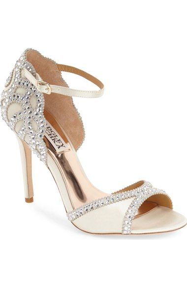 Free shipping and returns on Badgley Mischka 'Roxy' Sandals (Women) at Nordstrom.com. You wont lack for razzle-dazzle in this show-stealing sandal fashioned with a radiating array of light-catching crystals and a subtly scalloped topline.