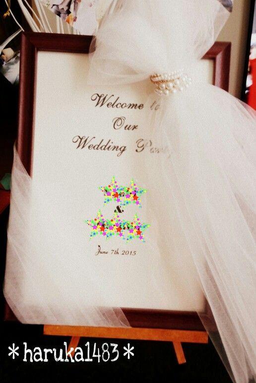 *DIY for my wedding*ウェルカムボード♡ダイソーのA4フレームにプリントしたミタント紙を入れただけ (*˙˘˙*)ஐ さらにアイディア頂きましたが、上からソフトチュールとパールのヘアゴムで飾りました♪♪ #ウェルカムボード #ウェルカムグッズ #ウェディング #手作り結婚式