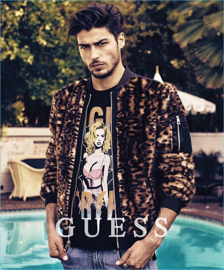 Alessandro Dellisola rocks a leopard print bomber jacket for Guess' holiday 2017 campaign.