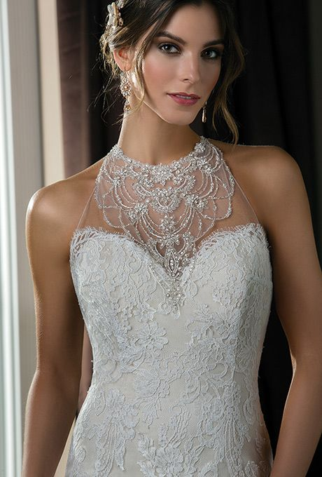 Brides: Jasmine Couture. Decadent, shimmering, and sexy, this dress is worthy of being the dazzling centerpiece for any wedding. The gown features beautiful French Leavers Lace with a halter neckline and mermaid skirt.