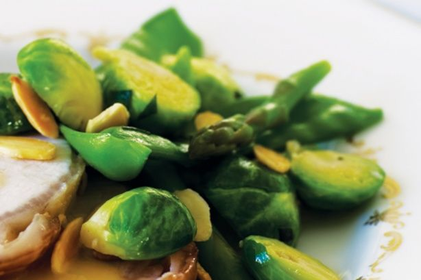 Make Brussels sprouts popular this Christmas with crunchy almonds and butter.
