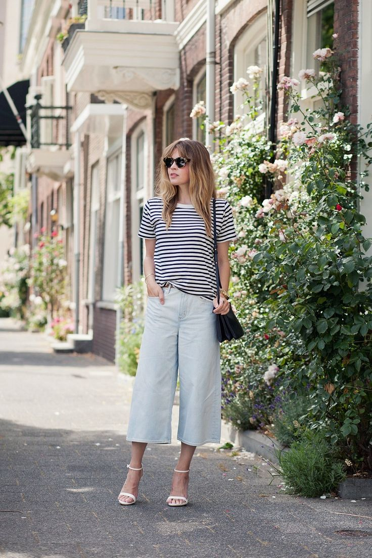 We're lovingChristine R in these culottes with a classic stripy tee and white heels!Trousers: COS, Top: COS, Heels: Zara