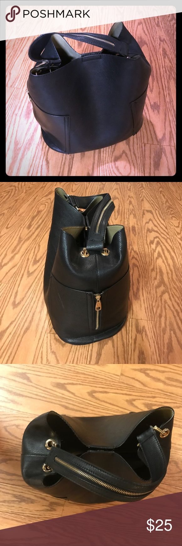 Black Pleather Hobo Shoulder Bag with Gold From a local store in my town. Big hobo shoulder bag with one big compartment and a clip in middle compartment with additional pockets. There are two side vertical zip pockets on the outside as well. It is fake leather. Bags Shoulder Bags