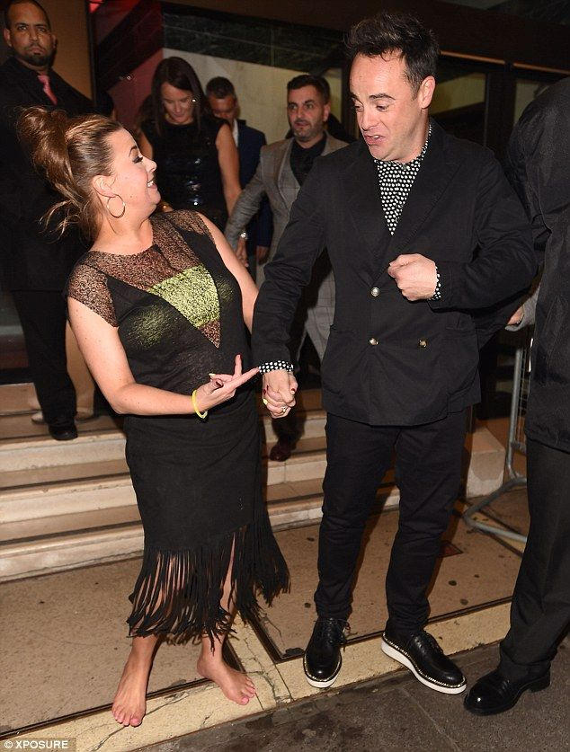 The ultimate girl prob: Ant's wife Lisa Armstrong ditched her heels as she left the venue ...