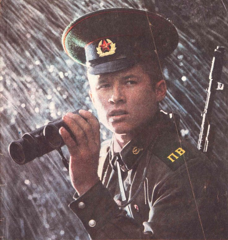 An enlisted servicemen of the Soviet Border Troops scouting in the rain.