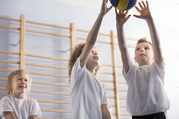 Happy Boys Playing Volleyball By Bialasiewicz Low Angle Of Happy Boys Playing Volleyball During Sports Activities At School Boys Playing Happy Boy Social Media Icons