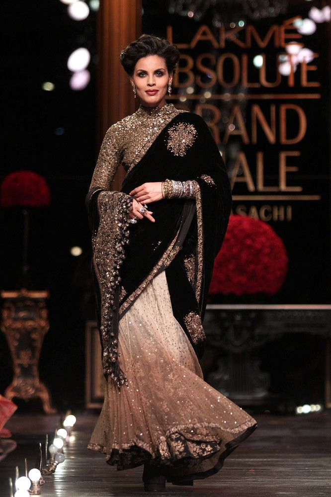 Sabyasachi Mukherjee A model showcases designs by Sabyasachi Mukherjee during Grand Finale on day 5 of Lakme Fashion Week Winter/Festive 2013 at the Hotel Grand Hyatt on August 27, 2013 in Mumbai, India.