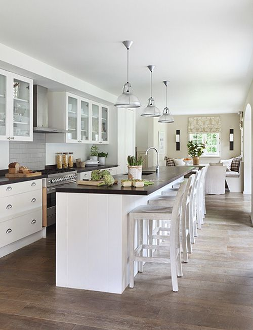 Not my aesthetic. Too white and cream' but like the dining on one end and functional kitchen layout,