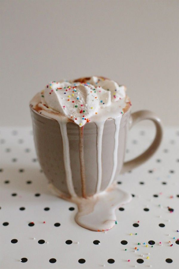 The best hot cocoa on Pinterest: Nutella hot chocolate topped off with cinnamon whipped cream