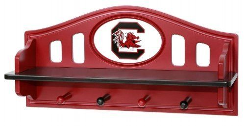 Fan Creations South Carolina Gamecocks Shelf With Pegs by Fan Creations. $38.99. Spruce up your little fan's room with this NCAA® shelf from Fan Creations®. It boasts a durable wood construction, includes 4 pegs that are perfect for hanging jackets and hats, and is decorated with a carved team logo.