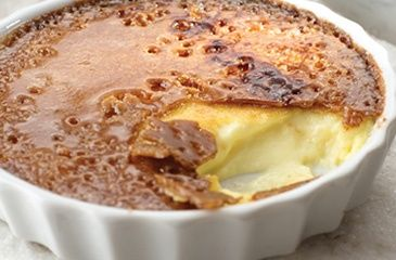 Crème Brûlée, 2 1/3 c heav cream, 2/3 c  milk, 1/4 c s, 3 egg yks, 1 tsp. vanilla, 3/4 c light brown s, O 300° Heat cream, milk, sugar in heavy saucepan almost boil. Other bowl, beat/blend egg yks. Gradually whisk heated mix in eggs,return mix to pan. Cook med heat, stir constant w/ wood spn til custard coats back spn, 3-4 mins; remove from heat. Stir in vanil. Pour custard in 6 dishes.