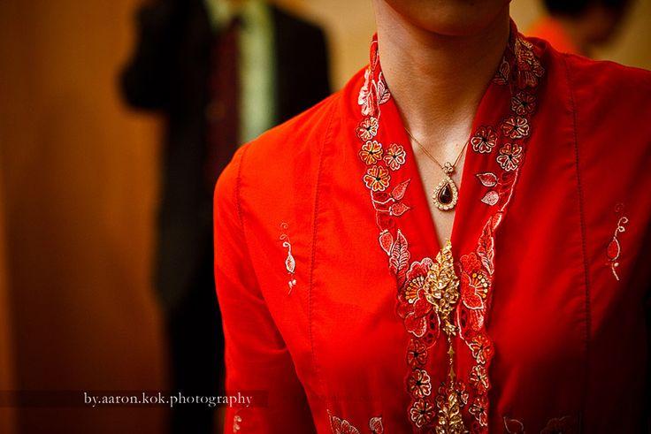 Kerongsang jewellery. Traditional nonya costume.