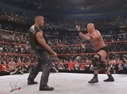 So, here's Stone Cold Steve Austin delivering a Stone Cold stunner to The Rock: | So, This Guy Got A Stone Cold Stunner At His Graduation