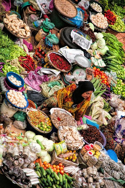 Markets in Malaysia are so colourful! Spices, vegetables, meat... Everything looks amazing! Vendor at Kota Bharu Central Market, Malaysia