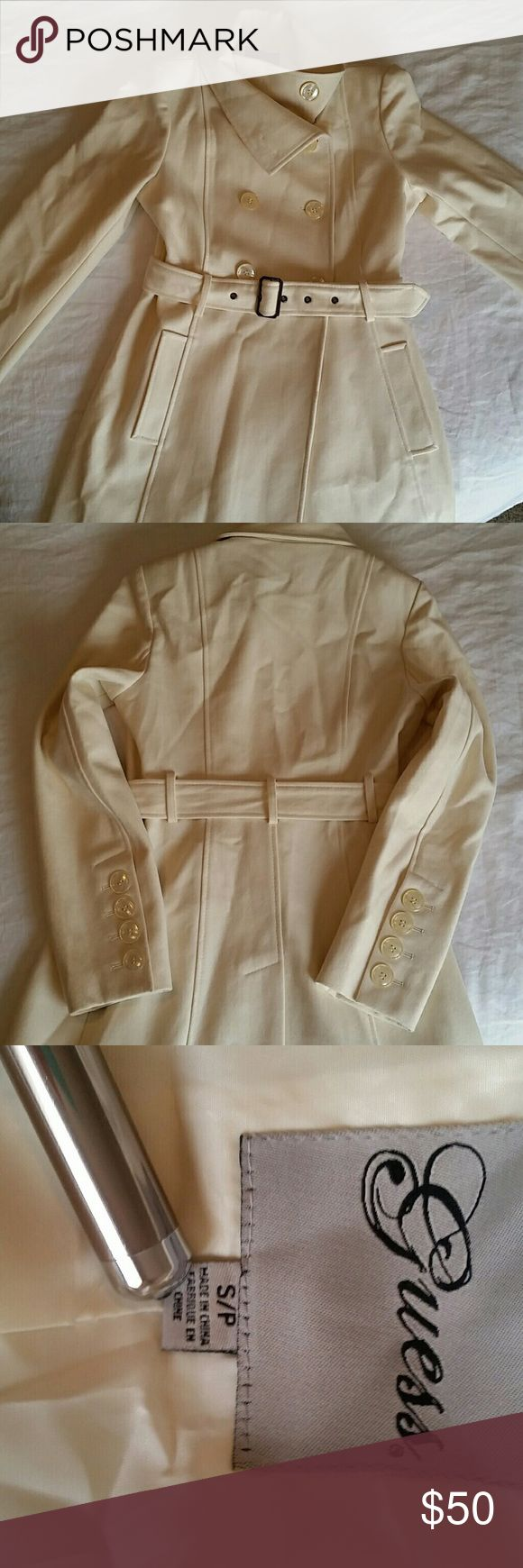 """Beautiful Ivory Guess Trench Coat Guess Ivory Double Breasted Trench Coat  Gorgeous ivory Guess coat! I only wore twice & due to mild FL winters I need to part with it. Flaws: There're some marks & spots; needs to be dry cleaned. IDK what the marks & spots are so not sure if they'll come out or not with a cleaning. They're small & not very noticeable. Last pic shows a small spot where it's piling as I attempted to get a spot out. Price reflects condition. Meas. Approx. 17"""" armpit to armpit…"""