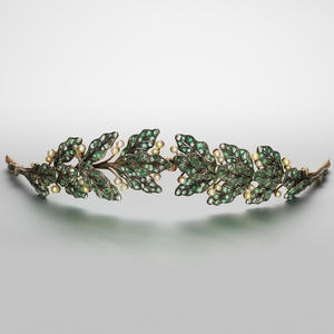 Emerald, pearl and diamond tiara, circa 1900.  Designed as a laurel wreath, pierced and millegrain-set with circular, step and mixed-cut emeralds, interspersed with pearl 'berries' and rose-cut diamond stems, pearls untested for natural origin