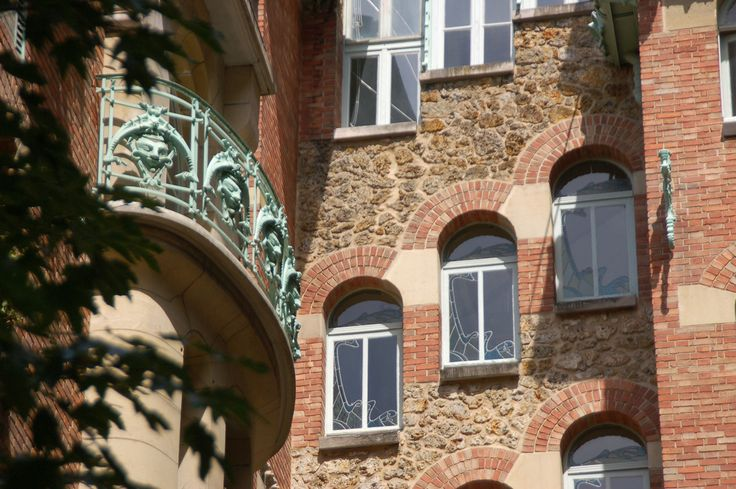 Castel Béranger - Mask balcony and stained glass windows in the stairwell