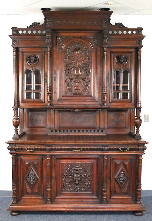 "Excellent example of a walnut Renaissance Revival Victorian cabinet or ""bookcase."" French c.1880. These were usually made in two sections. The top sometimes sat on large ""pins"" or directly on the base section. High relief carved doors and upper central door. Flat ""bun"" feet."