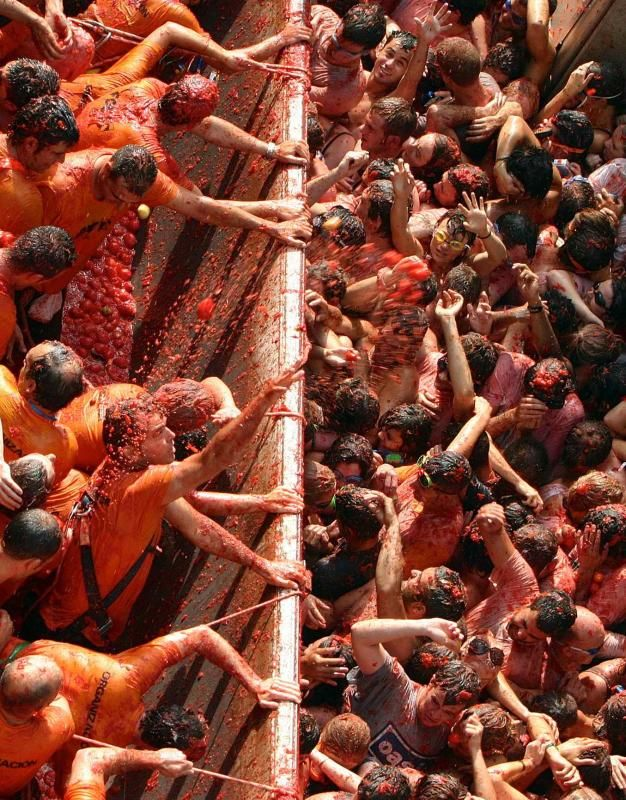 La Tomatina- a huge food fight in Spain every August where over ripe tomatoes are tossed at each other. Much safer than running with the bulls!