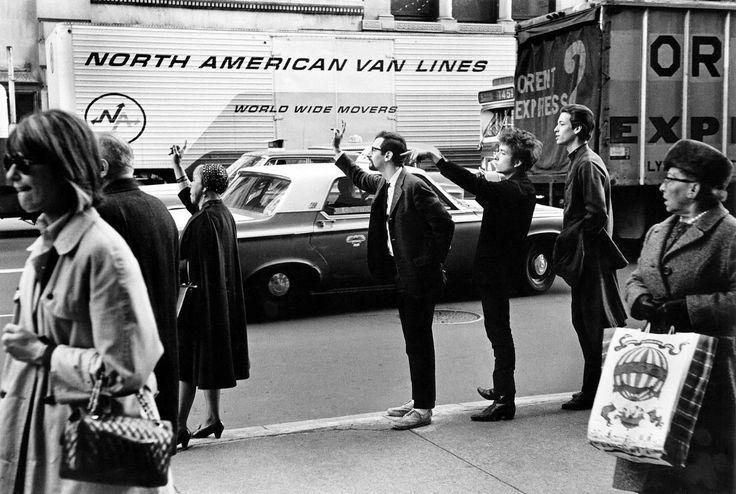 Bob Dylan, Peter Yarrow & John Hammond Jr. Hailing Taxi, NYC 1