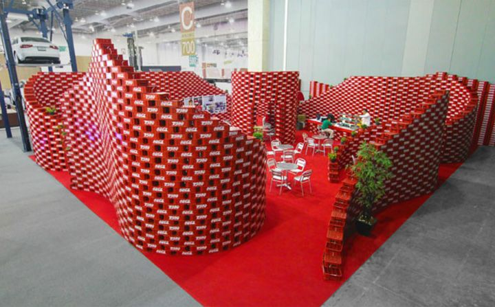 Inspired by the upcycling movement, that focuses on converting waste materials or useless products into new materials or products of better quality or for better environmental value, Coca-Cola conceived a pavilion made up exclusively of soda crates piled on top of each other.