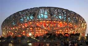 Birds Nest Stadium-Located in the Olympic Green, the stadium cost US$423 million. The design was awarded to a submission from the Swiss architecture firm Herzog & de Meuron in April 2003 after a bidding process that included 13 final submissions. The design, which originated from the study of Chinese ceramics, implemented steel beams in order to hide supports for the retractable roof; giving the stadium the appearance of a bird's nest.