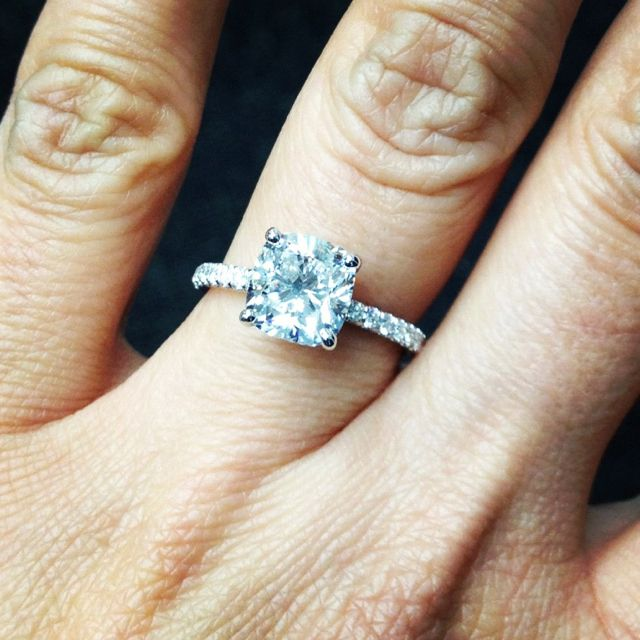 A beautiful 2 5 carat cushion cut diamond set in an ultra thin micro prong se