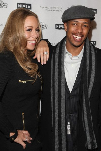 """Mariah Carey Photos - Singer/actress Mariah Carey (L) and actor Nick Cannon attend the dinner party for the screening of """"Push: Based On The Novel By Sapphire"""" held at the Phoenix Gallery during the 2009 Sundance Film Festival on January 16, 2009 in Park City, Utah.  (Photo by Jason Merritt/Getty Images) * Local Caption * Nick Cannon;Mariah Carey - """"Push"""" - 2009 Sundance Party"""