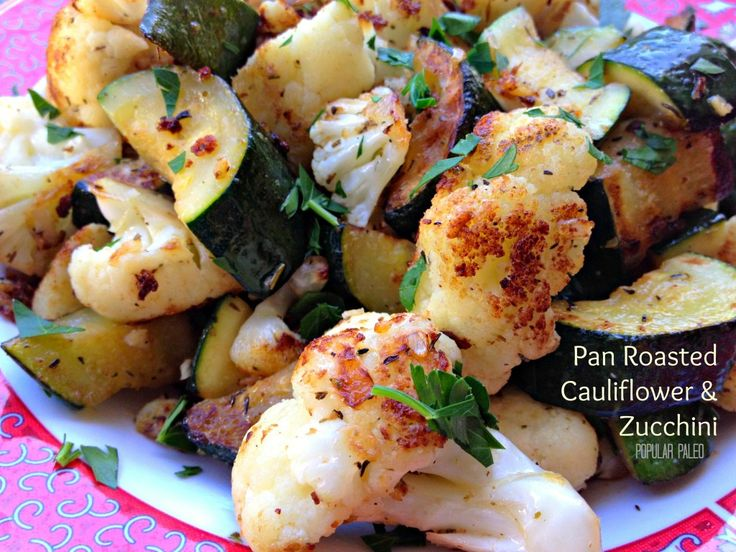 Cauliflower and zucchini pan roasted with Italian herbs and coconut oil. Easy side dish recipe, especially for using up that summer harvest of zucchini!