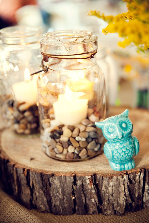 pictures of wedding centerpieces using mason jars%0A Mason jars filled with river rocks gravel and a votive on wood slivers