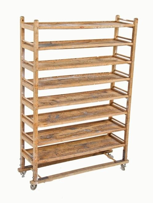 very unique and original american vintage industrial white oak wood baker's rack with original disc-shaped steel swivel wheels