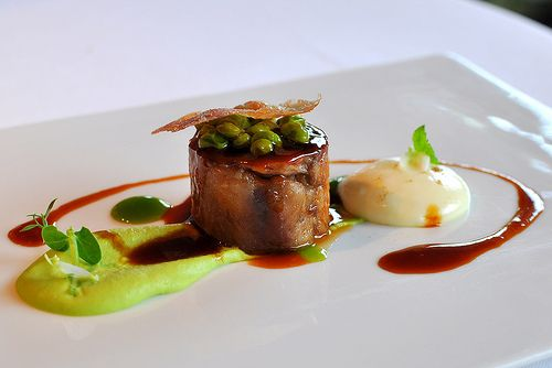 Lamb, Peas, and Mint; El Celler de Can Roca Restaurant - Girona This dish of perfectly cooked lamb with goat cheese and pea puree, minty accents, and topped with jerky crispsl