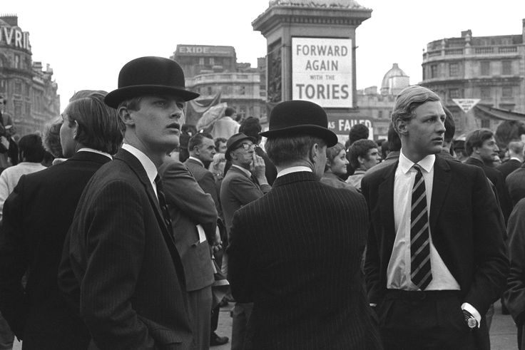 Young Conservatives at a political rally, Trafalgar Square, London. 1969 Bowler hatted, suited and wearing their old school ties, four young Conservative attend a 'Forward Again with the Tories' rally. Harold Wilson the Labour party leader won the 1966 General Election. Edward Heath, secured a surprise victory in 1970, the first election where 18 years old could vote.