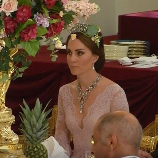 The Duchess of Cambridge looked regal wearing Princess Diana's favorite tiara and a necklace borrowed from Queen Elizabeth.
