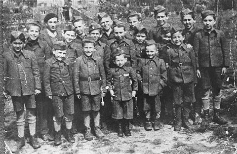 Child Survivors of Buchenwald wearing clothes made from German military uniforms