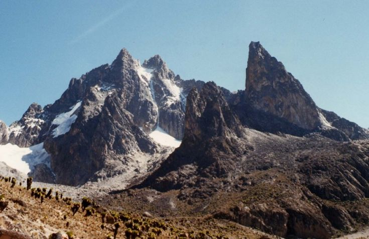 Mount Kenya - In the Mount Kenya National Park, this monster of a mountain stands 17058 feet high (5199 meters) and is the second highest mountain in Africa. Its highest peaks are Batian, Nelion, and Point Lenana. The mountain is located in the center of Kenya just south of he equator. It is a stratovolcano created roughly 3 million years after the opening of the East African Rift.