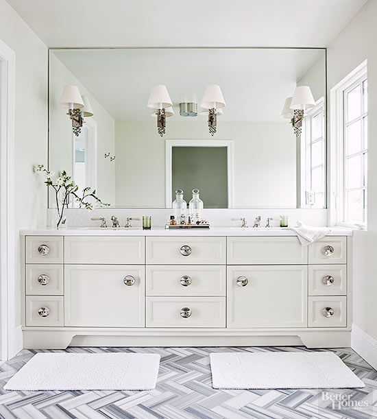 Love the gray and white herringbone tile in this bathroom