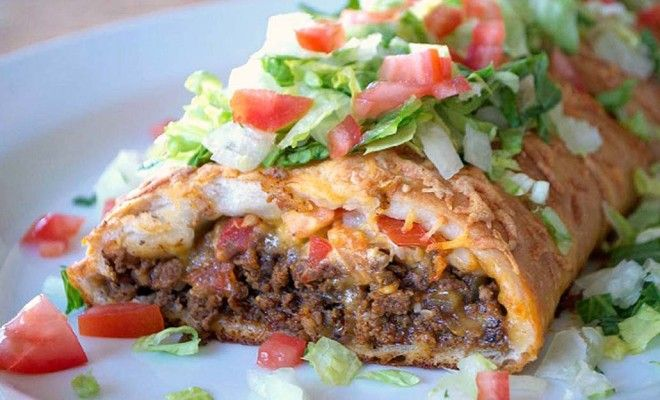 Taco Braid.... 1 canister refrigerated pizza crust 2 tablespoons olive oil 1/2 cup chopped onion 1 lb. 93/7 super lean ground beef 3 tablespoons taco seasoning 1/2 cup water 1 cup fiesta blend shredded cheese, divided 1 tomato, diced, plus additional for top, if desired 2 tablespoons unsalted butter, melted 2 cups chopped Romaine lettuce Sour cream and taco sauce for serving, if desired