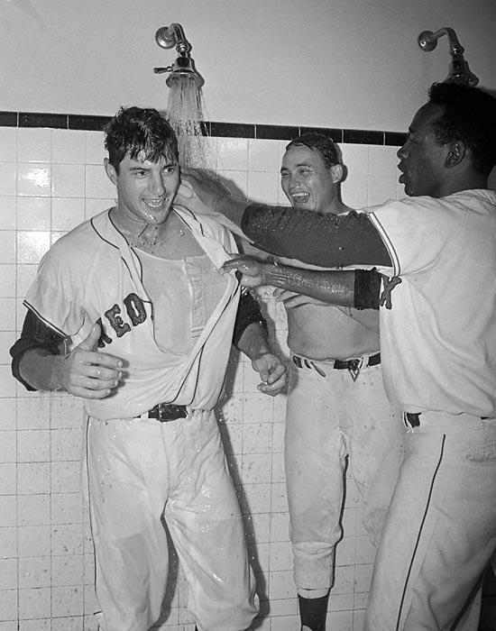 Carl Yastrzemski, Jose Santiago and Jose Tartabull celebrate after beating Minnesota to advance to the World Series.  Photographed by: Bettmann/CORBIS