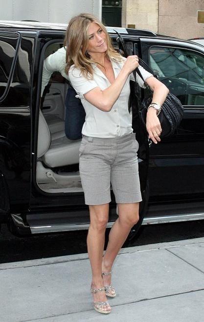 Bermuda shorts are back! Jennifer Aniston rocks them in khaki with a strappy heel for an elevated daytime look.